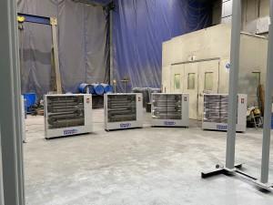 Diesel Heaters set up to dry steel pergolas